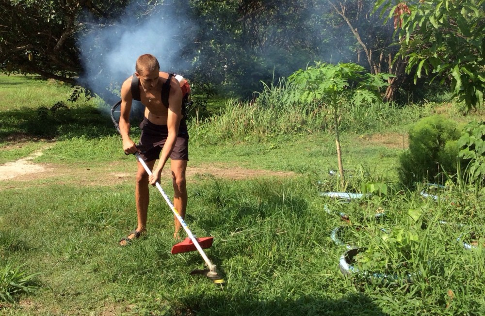 Kaspars with grass cutter - Langkawi island, Malaysia