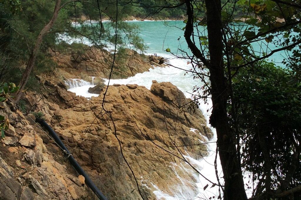 rocks waves Phuket Thailand