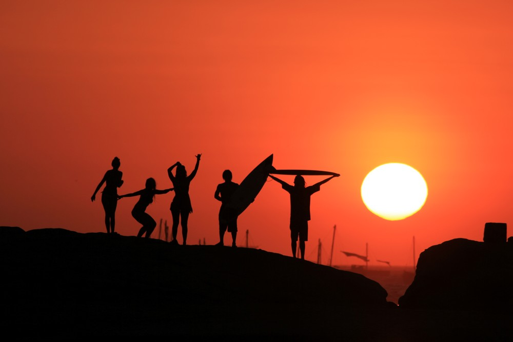 Beautiful red sunset and silhouettes of people - South America travels