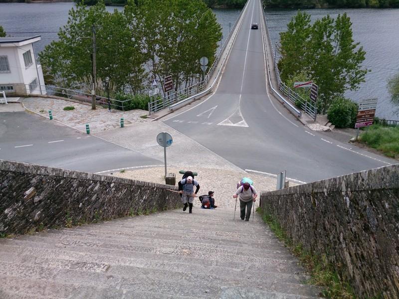Climbing stairs in Portomarin, Camino de Santiago, Spain