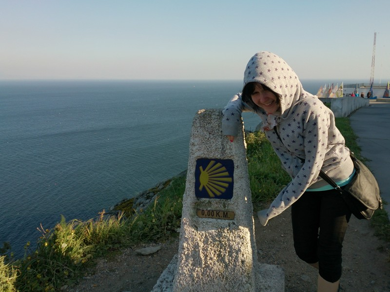 Una at The end of the earth, Cape Finisterre, Walking Camino de Santiago, Spain