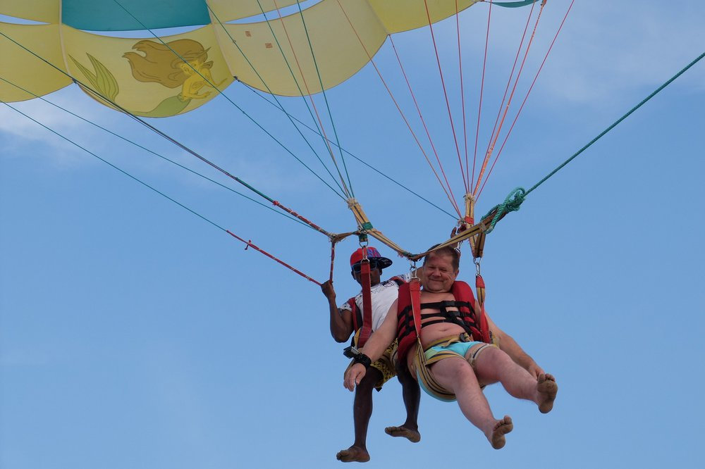 dad trying parasailing in Goa India