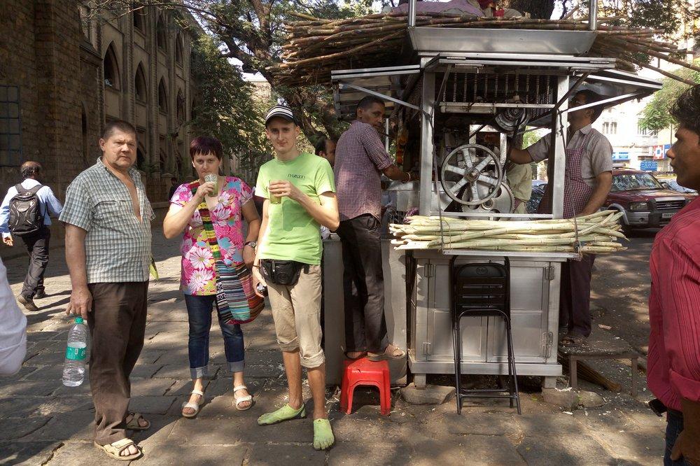 drinking sugar cane juice in Mumbai India