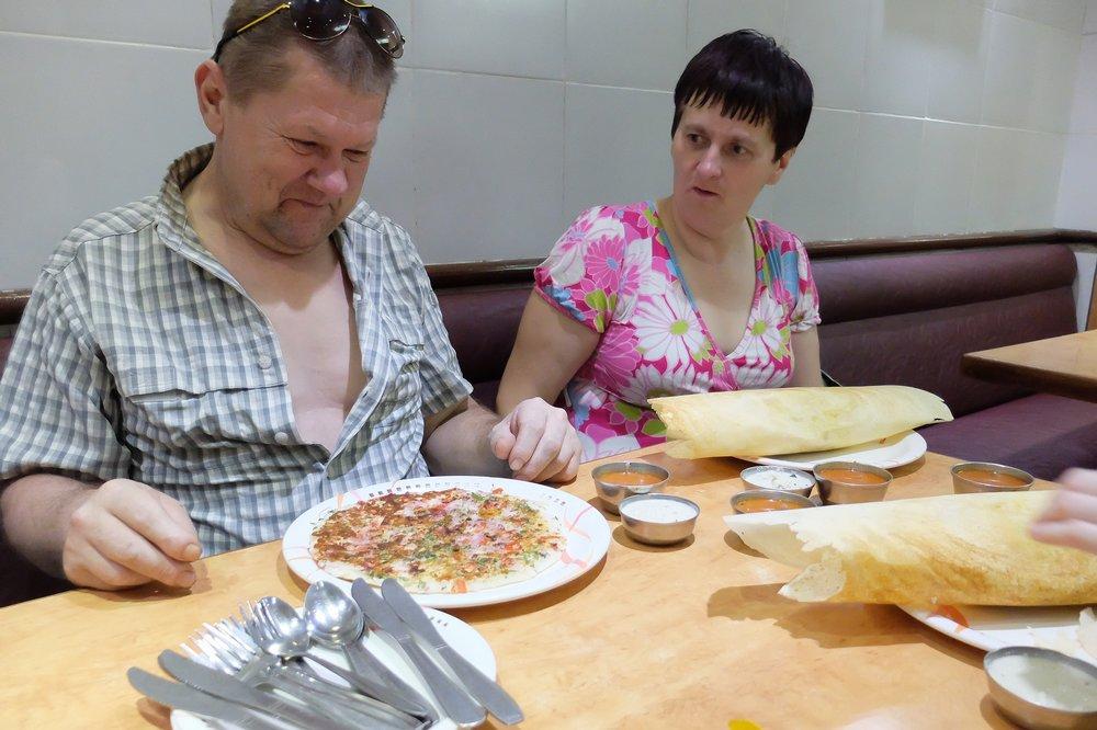 eating masala dosa and uttapam