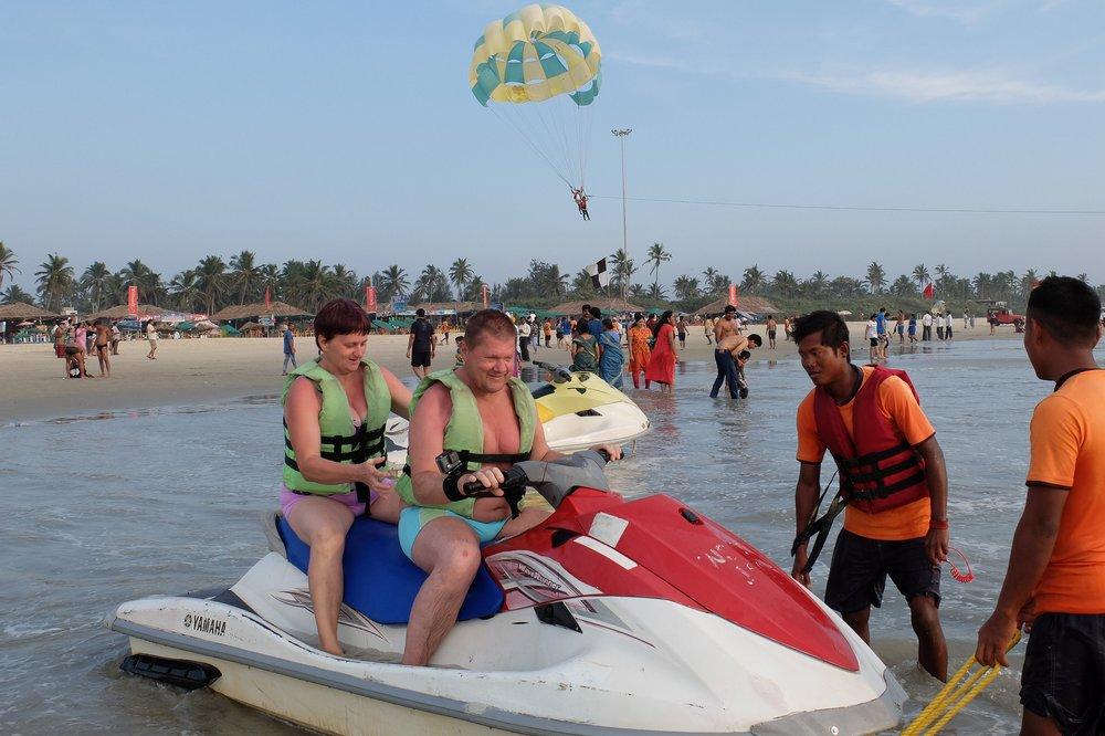 mom and dad on jetski in Goa India