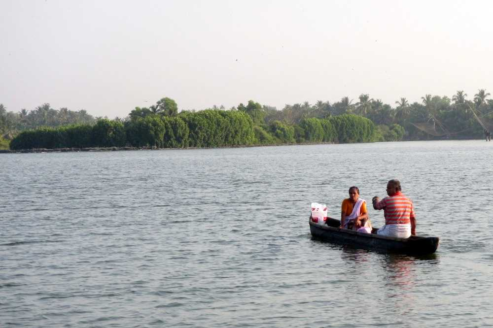 Man and woman coming back from shopping - Kerala backwaters tour