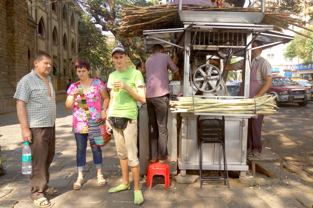 Kaspars and his Parents Drinking Sugar Cane Juice