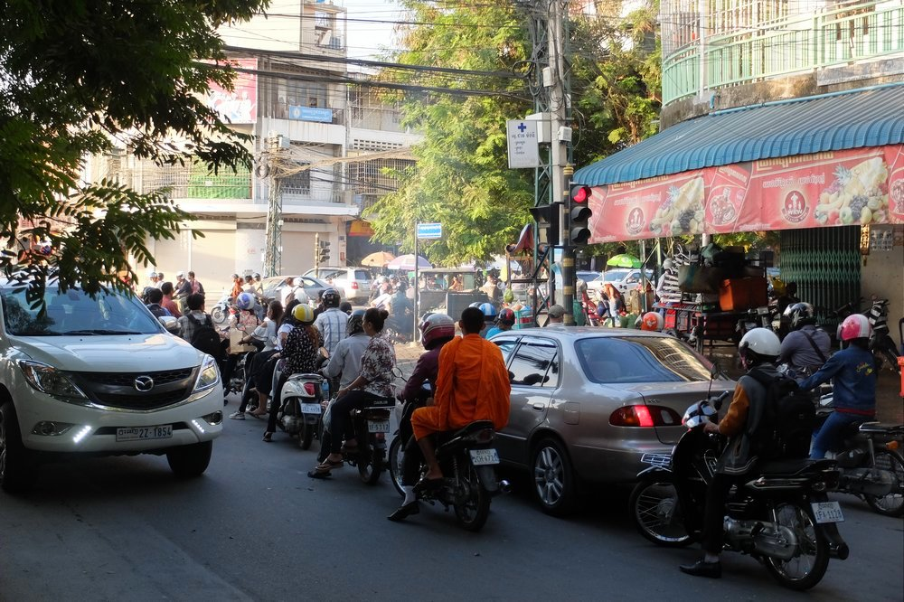 traffic in Phnom Penh - Motorbike Trip Across Cambodia
