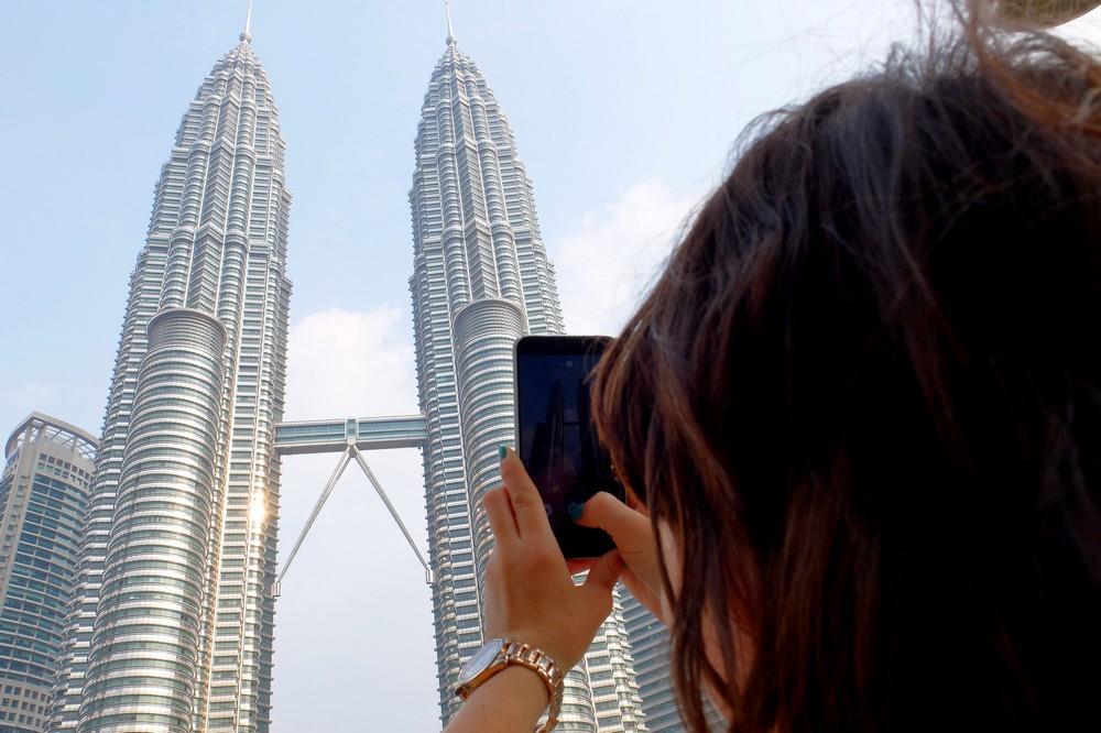 Una is taking a photo of Petronas Towers, Kuala Lumpur