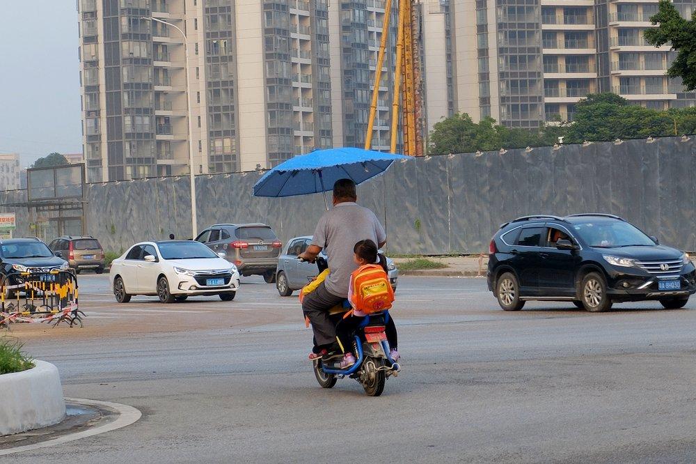 Man cycling in Guanzhou - Layover in Guanzhou