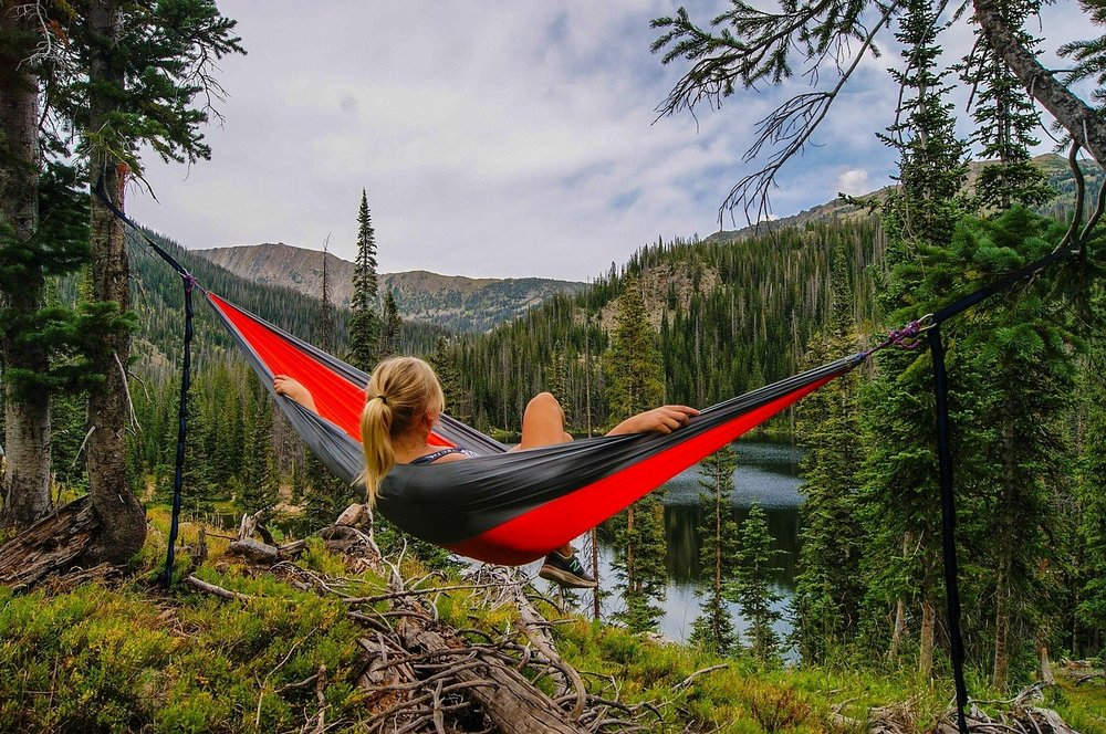 Lying in a hammock in forest