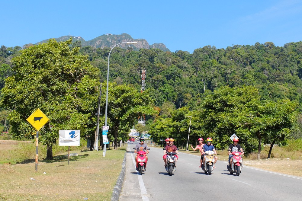 Kaspars and our friends on scooters on Langkawi island, Malaysia - Renting a scooter in Langkawi