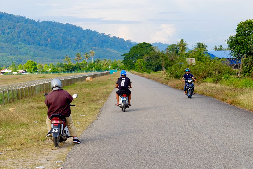 Men on scooters in Langkawi, Malaysia - Renting a scooter in Langkawi