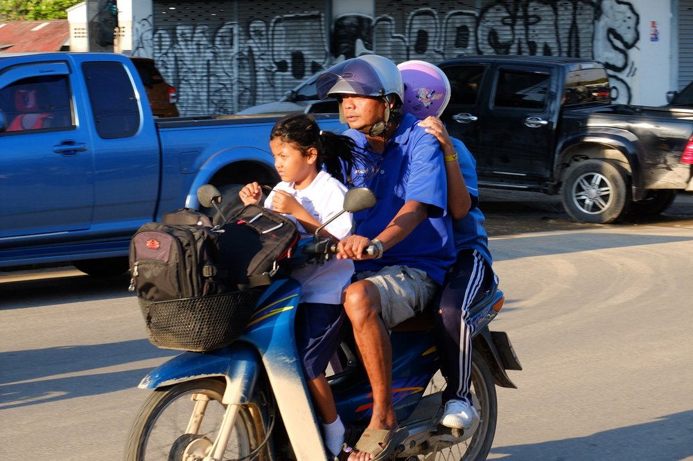 Family on a motorbike in Thailand