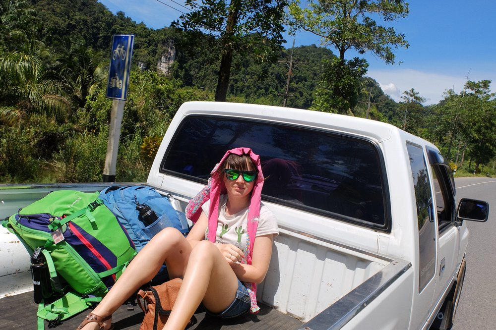 Una sitting at the back of the pickup truck - Hitchhiking in Thailand