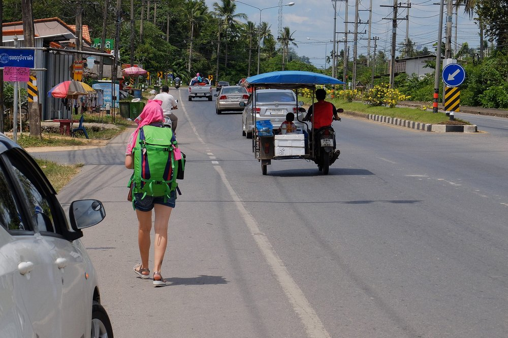 Una walking on the side of the road - Hitchhiking in Thailand