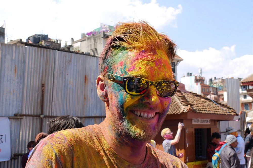 A man with colorful face - Kathmandu - Holi in Nepal