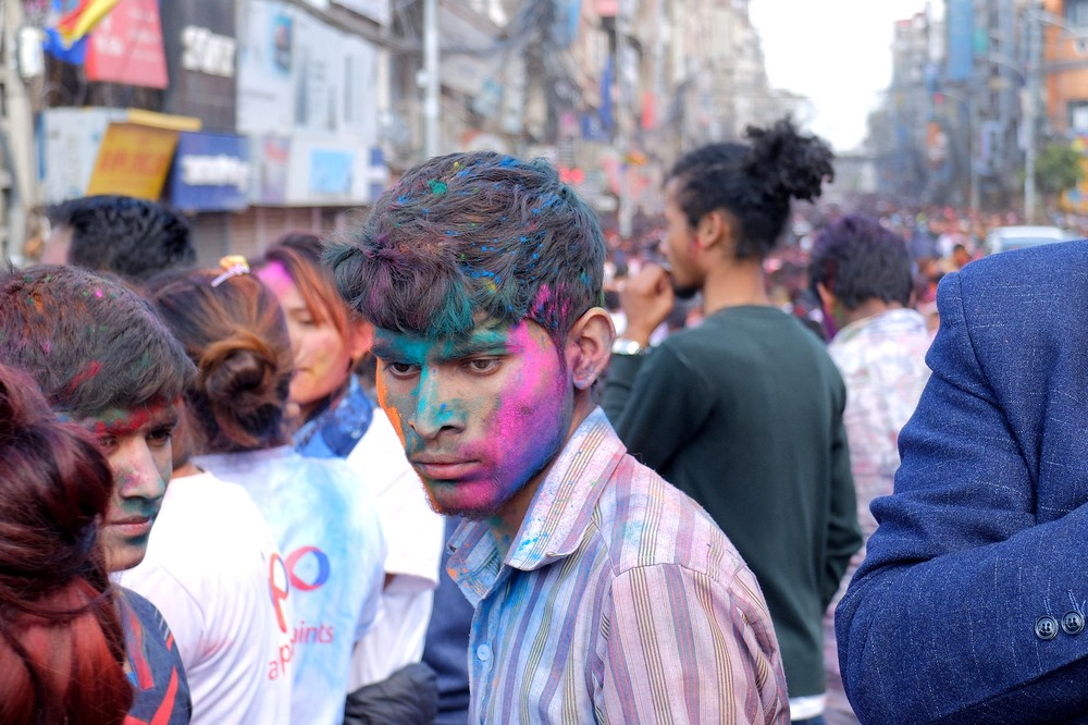 Guy with a colorful face - Kathmandu - Holi in Nepal