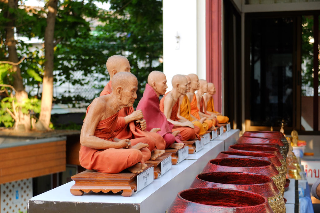 Statues of monks in Bangkok - Bangkok Singapore Overland Backpacking Itinerary