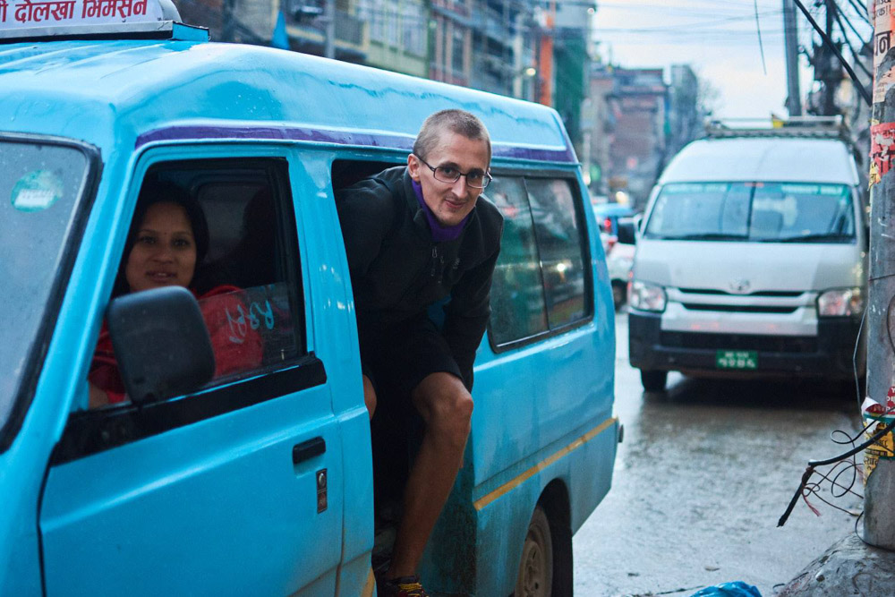 Getting out of tuktuk in Kathmandu - Transportation in Nepal