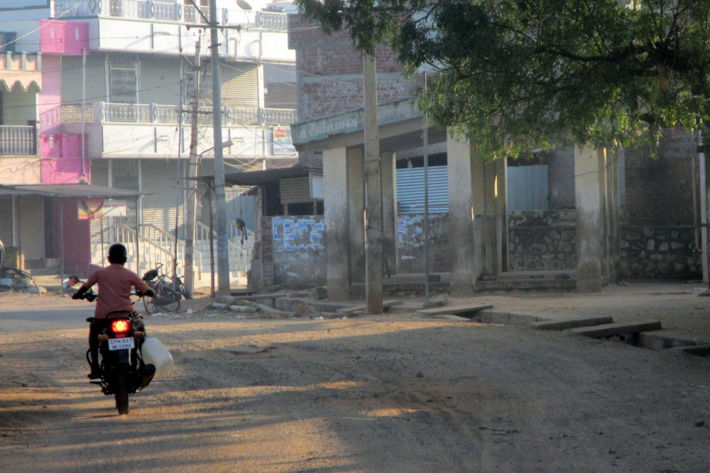 Kid driving a motorcycle in India