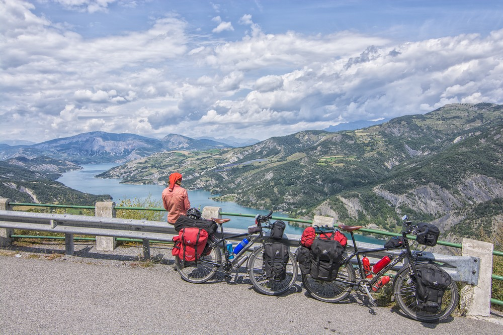 Lake viewpoint in the Alps. Ilze. Cycling around the world.