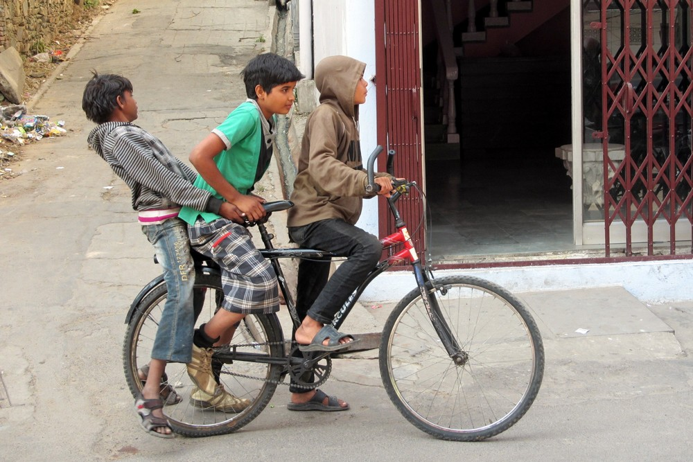 Boys on a bicycle in Udaipur, India