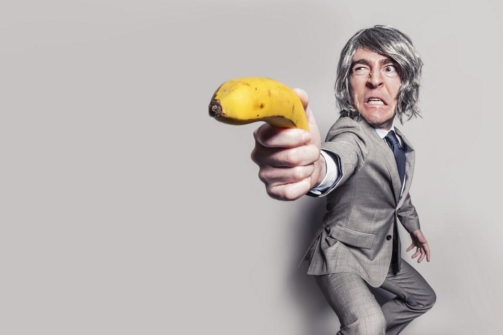 A man with a banana gun