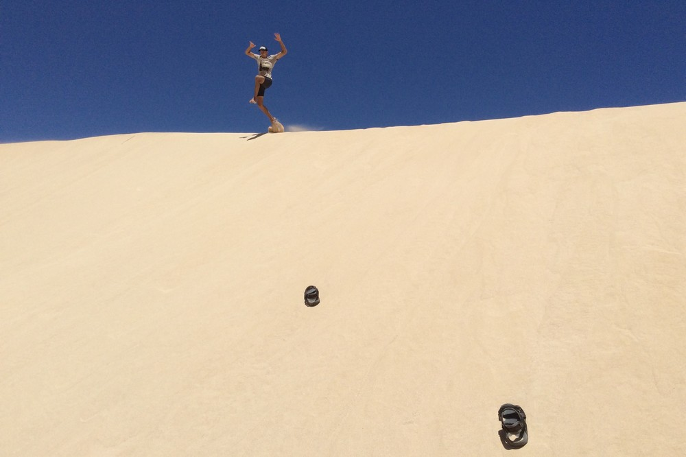 Kaspars jumping on sand dunes in Corralejo - Fuerteventura, Canary Islands