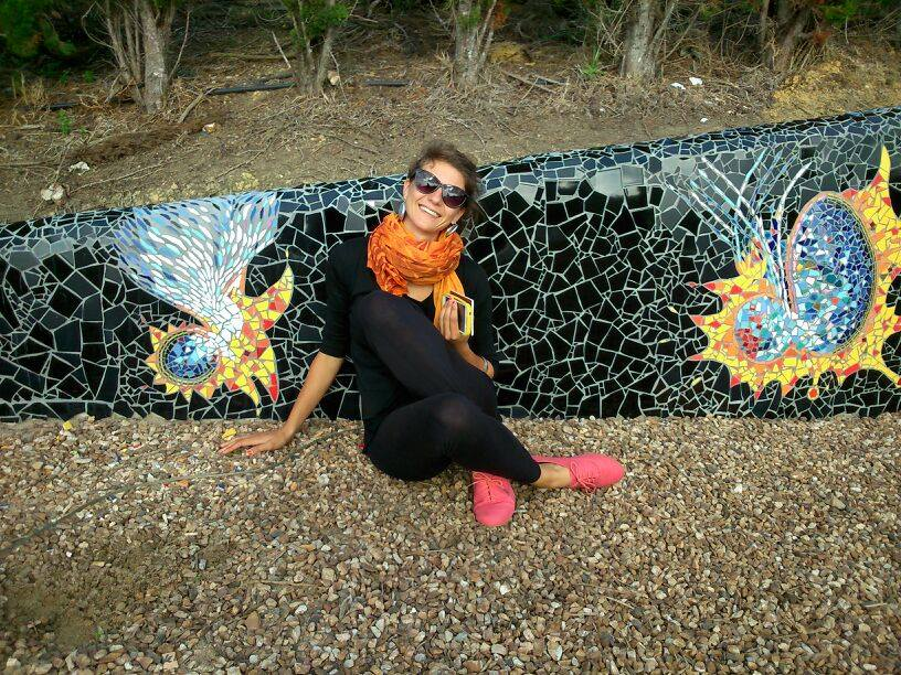 Linda Rinke by mosaic wall in New Zealand