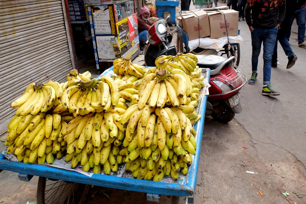 A man selling bananas in India