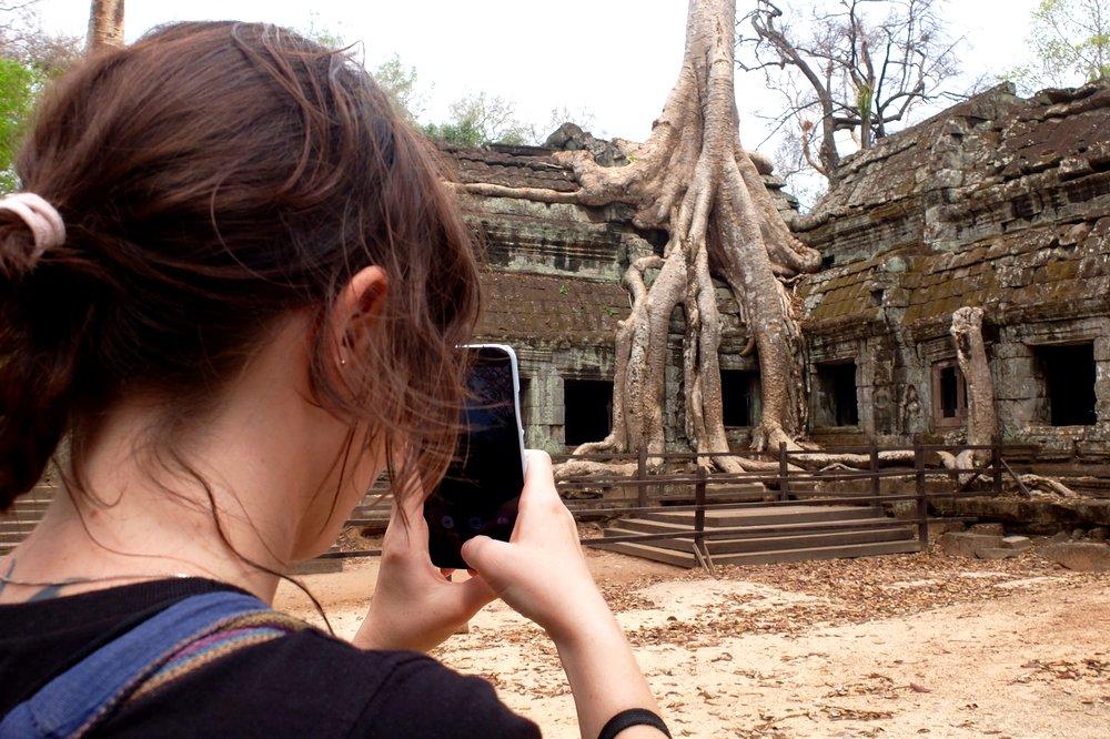 Una taking a photo at Angkor temple complex - Cambodia
