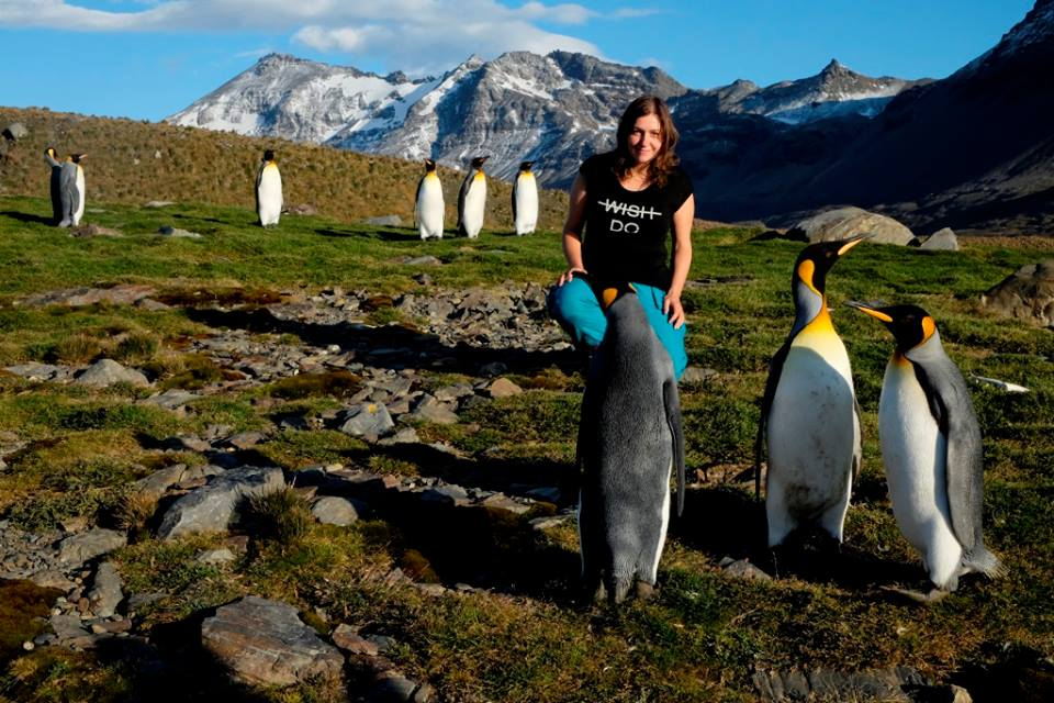 Zane Enina and penguins - Why go to Antarctica