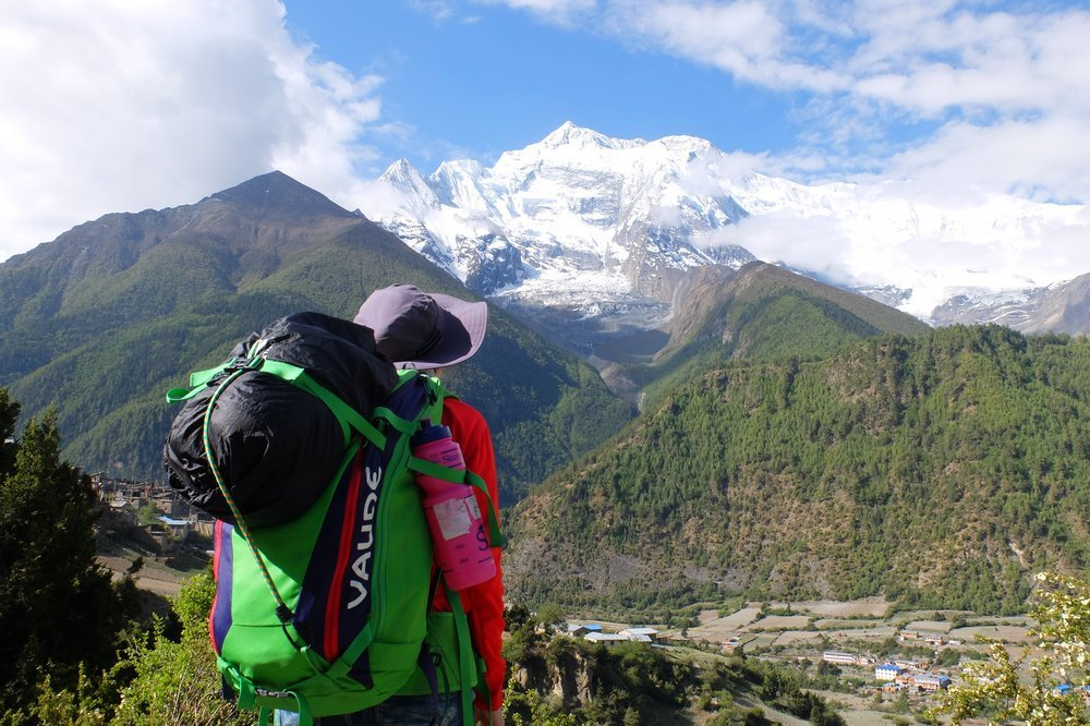 Una trekking in Nepal with her Vaude carry on backpack - Best carry on backpacks