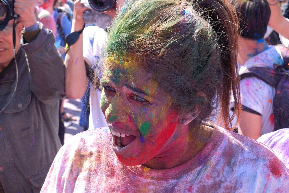 A girl with mouth full of colorful powder - Kathmandu - Holi in Nepal
