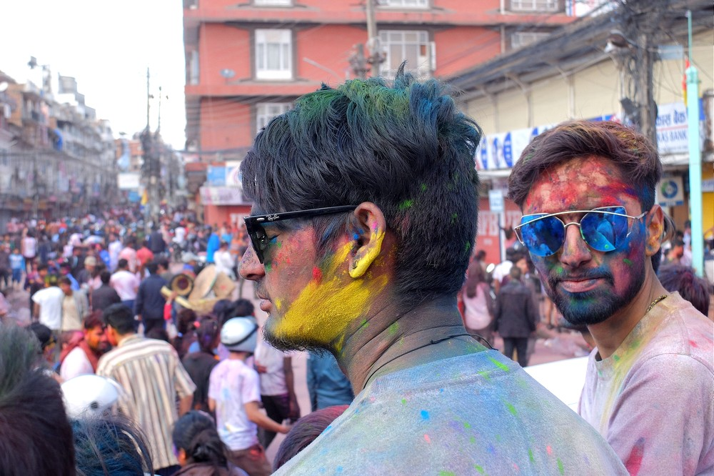 Indian guy with yellow face - Kathmandu - Holi in Nepal