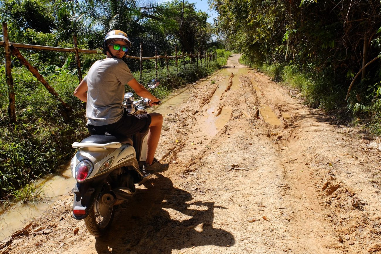 Kaspars driving a scooter near Krabi, Thailand - How We Started to Travel