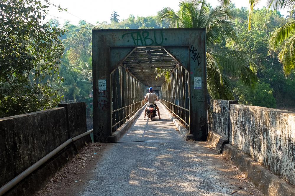 Kaspars on a bike in Goa India - How We Afford to Travel