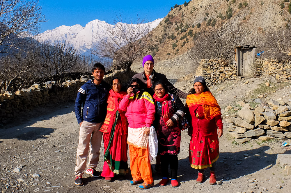 Kaspars with local Nepalese people in the mountains - Traveling Like a Local