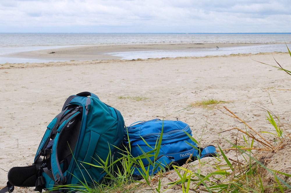 Osprey Farpoint and Osprey Fairview Backpacks on a Beach in Latvia
