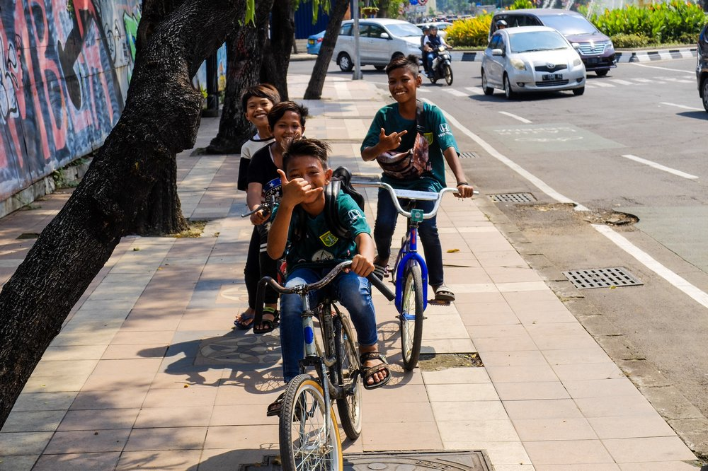 Kids on bicycles in Surabaya, Indonesia - My Long Journey to Thailand