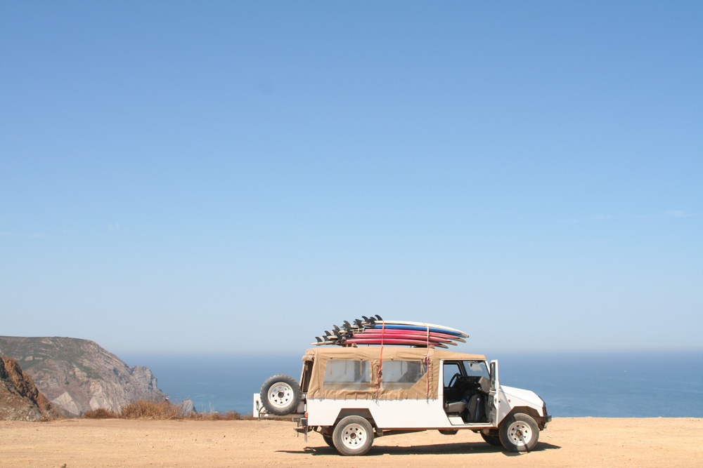 A car with surfboards on its roof - Best Duffel Bags for Travel