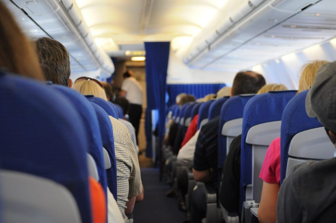People on the airplane - best travel pillows