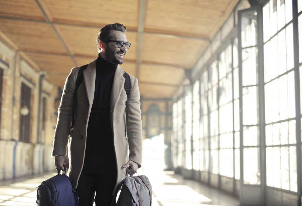 A Man with Two Bags - Best Luggage Straps