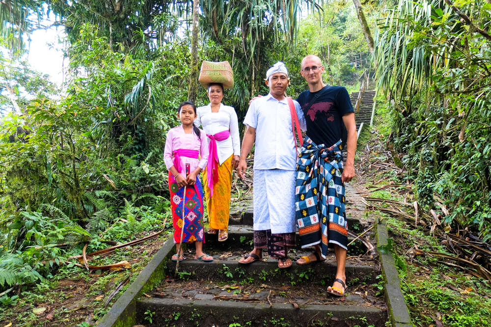Taking a photo with locals near a temple in Bali