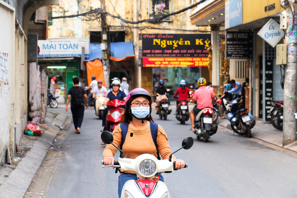 A girl driving a scooter in Ho Chi Minh City - Vietnam Photo Story