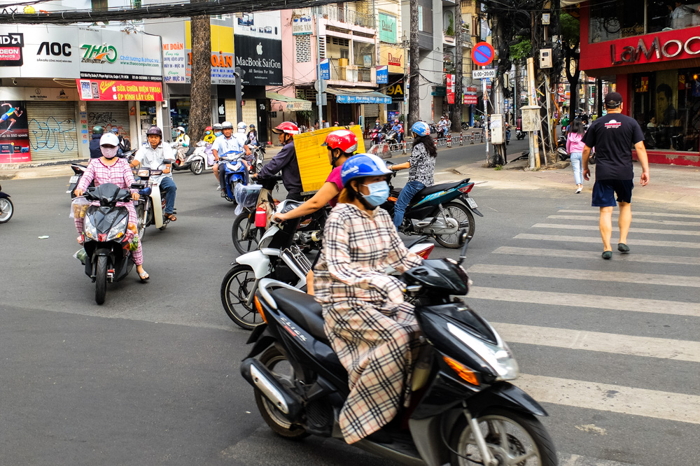 Covered woman riding a scooter in Ho Chi Minh City - Vietnam Photo Story