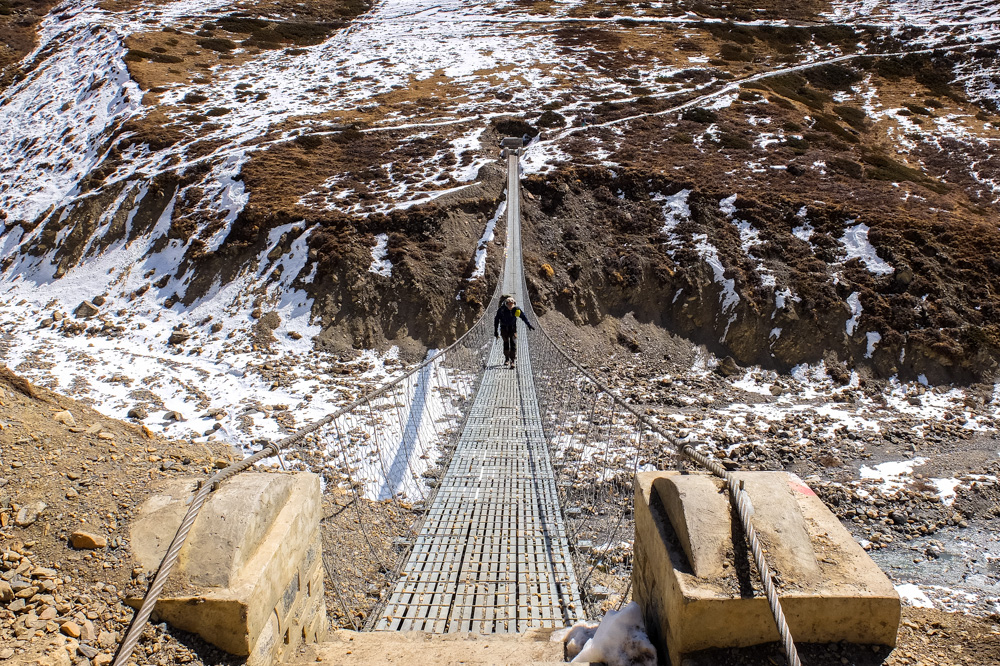 Crossing a suspension bridge on the way to Thorung Pedi - Annapurna Circuit Photos