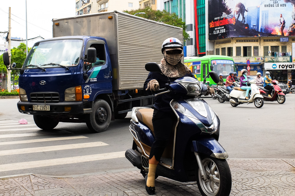 Fully covered woman on a scooter in Ho Chi Minh City - Vietnam Photo Story