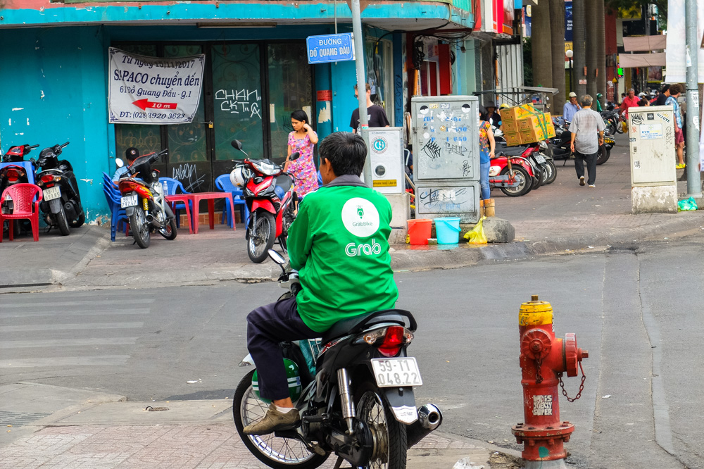 Grab bike driver in Ho Chi Minh City - Vietnam Travel Tips